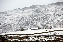 © Licensed to London News Pictures. 08/12/2017. Llanberis UK. A snow covered building this morning in Capel Curing in in the Snowdon national park. Photo credit: Andrew McCaren/LNP