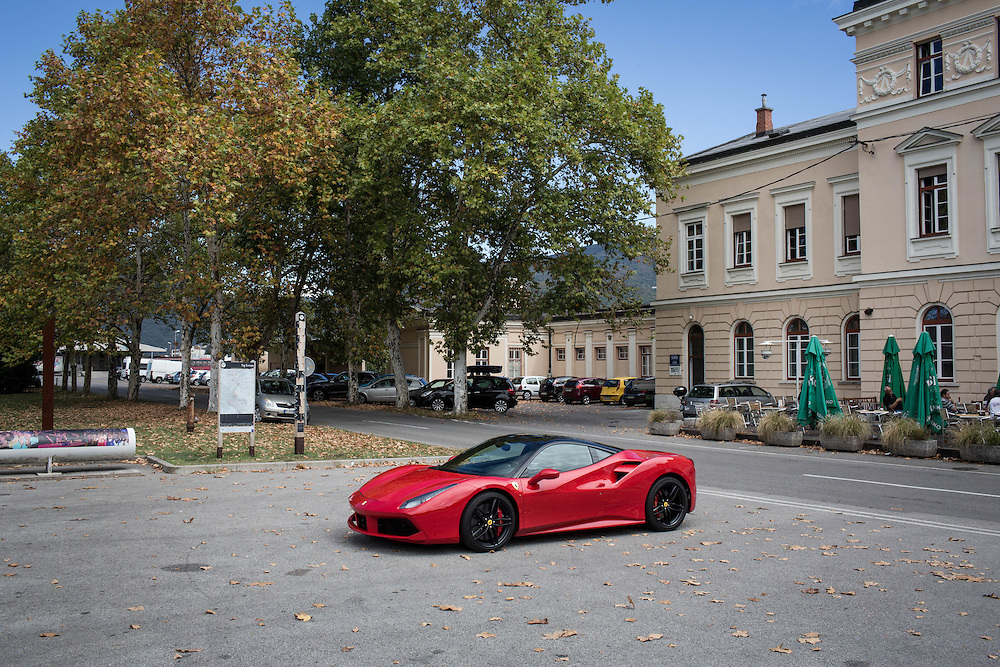 A Ferrari is parked in the &ldquo;Piazza della Transalpina&rdquo;. The square is divided between the towns of Gorizia and Nova Gorica.<br /> The peace treaty of Paris of 1947 established the new borders between Italy and Yugoslavia. Gorizia was literally divided, the border became for decades the painful symbol of a city in which an unnatural bound had divided many families from their relatives, many people from their beloved deceased and even homes from their barns and fields.<br /> The entry of Slovenia into the EU and the Schengen area dissolved the existing border between the Italian and Slovenian part of the city of Gorizia. The dividing line between the two countries is now the most open of the continent.