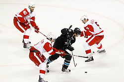 May 8, 2011; San Jose, CA, USA; San Jose Sharks center Logan Couture (second from right) controls the puck as Detroit Red Wings center Henrik Zetterberg (40), left wing Justin Abdelkader (8), and defenseman Nicklas Lidstrom (5) defend during the first period of game five of the western conference semifinals of the 2011 Stanley Cup playoffs at HP Pavilion. Mandatory Credit: Jason O. Watson / US PRESSWIRE