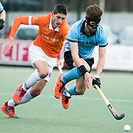 WASSENAAR - Hoofdklasse hockey heren, HGC-Bloemendaal (0-5)  Steijn van Heijningen (HGC) met links Xavi Lleonart Blanco (Bldaal)     COPYRIGHT KOEN SUYK