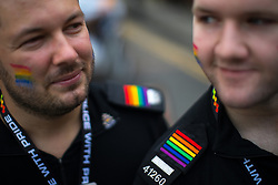 © Licensed to London News Pictures . 26/08/2017. Manchester , UK. Police officers at the 2017 Pride parade through Manchester City Centre . The annual festival , which is the largest of its type in Europe , celebrates LGBT life . Photo credit : Joel Goodman/LNP