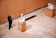 Man admiring sculpture artwork in a museum, Thyssen-Bornemisza, Museum, Madrid, Spain