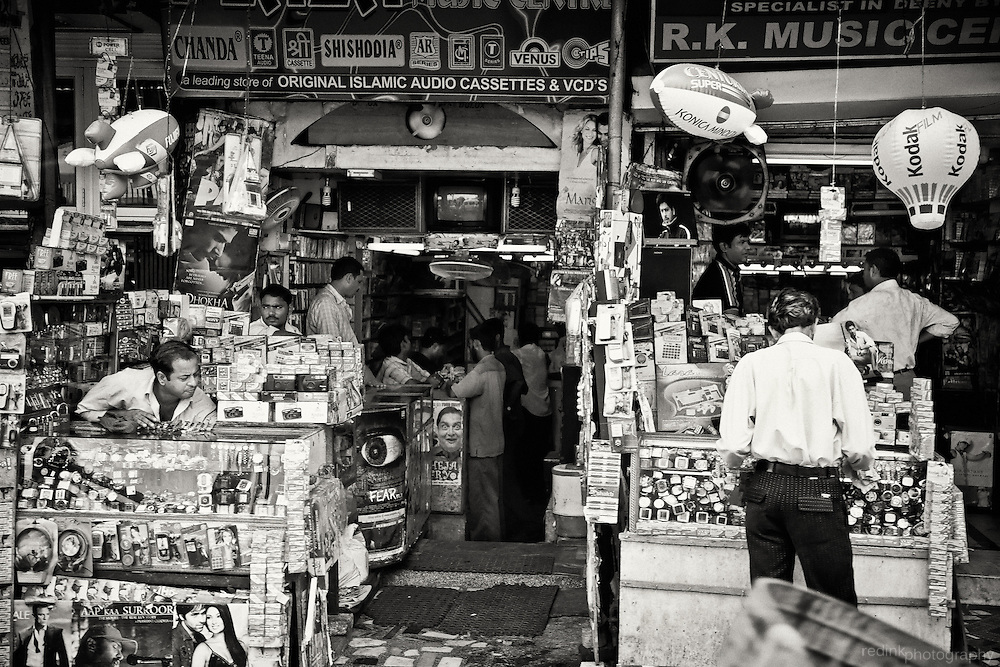 People browse an Islamic record store in the streets near Jama Masjid in New Delhi, India. Converted to black and white using Silver Efex Pro.