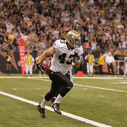 2008 September 28: New Orleans Saints safety Kevin Kaesviharn (43) returns an interception from the end zone during the NFL week four game between the San Francisco 49ers and the New Orleans Saints at the Louisiana Superdome in New Orleans, LA.