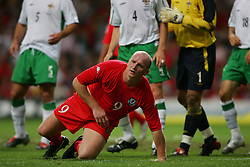 CARDIFF, WALES - Wednesday, September 8, 2004: Wales' John Hartson in action against Northern Ireland during the Group Six World Cup Qualifier at the Millennium Stadium. (Pic by David Rawcliffe/Propaganda)