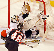 Flyers' Daniel Briere takes shot on Pittsburgh Penguins' goalie Marc-Andre Fleury and he skate saves the puck during the second period in game 4 of the Eastern Conference Finals at the Wachovia Center in Philadelphia.