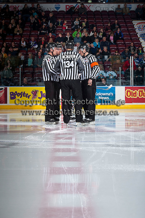 KELOWNA, CANADA - OCTOBER 23: Ice officials, Jeff Ingram, Mark Pearce, Kevin Crowell and Dave McMahon stand at centre ice as the Kelowna Rockets take on the Prince George Cougars on October 23, 2015 at Prospera Place in Kelowna, British Columbia, Canada.  (Photo by Marissa Baecker/Shoot the Breeze)  *** Local Caption *** Jeff Ingram; Mark Pearce; Kevin Crowell; Dave McMahon;