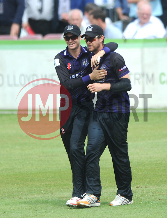 Ian Cockbain of Gloucestershire celebrates with Peter Handscomb of Gloucestershire  - Photo mandatory by-line: Dougie Allward/JMP - Mobile: 07966 386802 - 14/07/2015 - SPORT - Cricket - Cheltenham - Cheltenham College - Natwest T20 Blast