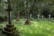 Stone crosses in the wild cemetery of St. Mark's Church on 13th September 2018, in Brithdir, near Dolgellau, Gwynedd, Wales.