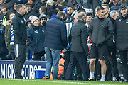 The volunteer from the crowd talks to the ref about taking over as 4th official during the EFL Sky Bet League 1 match between Peterborough United and Rotherham United at London Road, Peterborough, England on 25 January 2020.