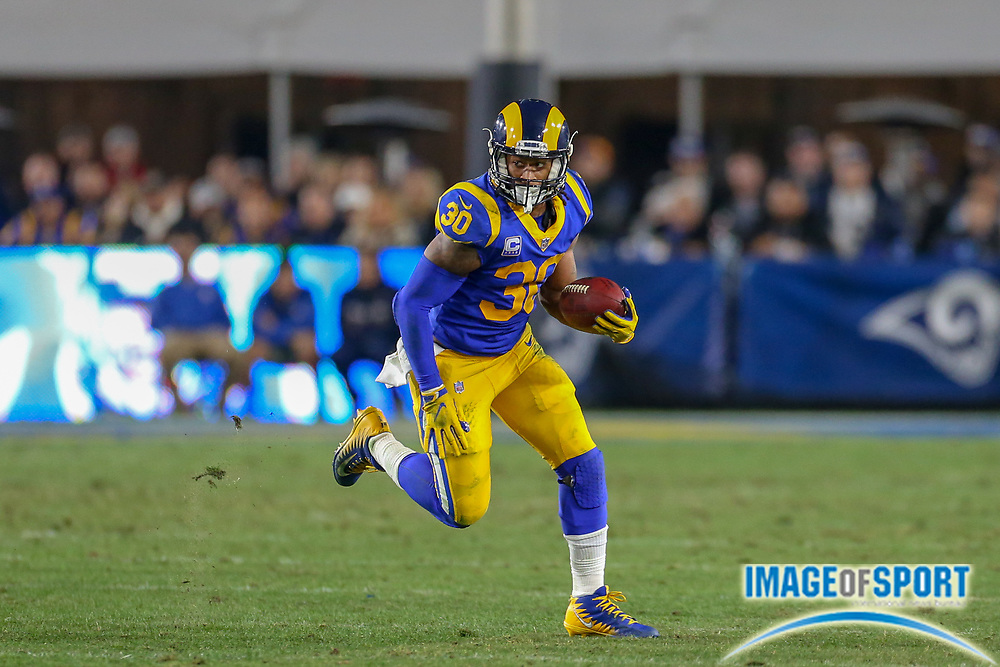 Jan 12, 2019; Los Angeles, CA, USA;  Los Angeles Rams running back Todd Gurley (30) carries the ball against the Dallas Cowboys during an NFL divisional playoff game at the Los Angeles Coliseum. The Rams beat the Cowboys 30-22. (Kim Hukari/Image of Sport)