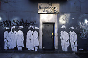 Entrance to the Nuyorican Poets Caf¬ø, surrounded by stenciled figures, New York, USA, 2000's