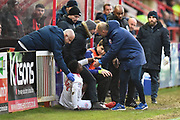 Mekhi Leacock-McLeod (14) of Accrington Stanley is helped up after sliding into the pitchside fence during the EFL Sky Bet League 2 match between Exeter City and Accrington Stanley at St James' Park, Exeter, England on 25 November 2017. Photo by Graham Hunt.