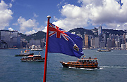 The British Hong Kong flag flies over Hong Kong harbour for the last few hours, on the eve of the handover of sovereignty from Britain to China, on 30th June 1997, in Hong Kong, China.  Midnight signified the end of British rule, and the transfer of legal and financial authority back to China. Hong Kong was once known as 'fragrant harbour' (or Heung Keung) because of the smell of transported sandal wood.