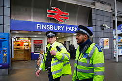 © Licensed to London News Pictures. 07/12/2015. London, UK. Police officers patrolling outside Finsbury Park station in London on Monday, 7 December 2015. Photo credit: Tolga Akmen/LNP