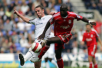 Photo: Paul Thomas.<br /> Bolton Wanderers v Liverpool. The Barclays Premiership. 30/09/2006.<br /> <br /> Kevin Nolan of Bolton battles with Momo Sissoko (R).