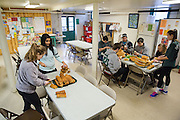 Student volunteers for the MLK day of service slice bread for the United Campus Ministries Saturday lunch.