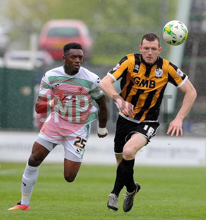 Yeovil Town's Gozie Ugwu is tackled by Port Vale's Neill Collins- Photo mandatory by-line: Harry Trump/JMP - Mobile: 07966 386802 - 25/04/15 - SPORT - FOOTBALL - Sky Bet League One - Yeovil Town v Port Vale - Huish Park, Yeovil, England.