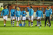 The Forest Green players take a drinks break during the warm up during the Vanarama National League match between Aldershot Town and Forest Green Rovers at the EBB Stadium, Aldershot, England on 4 October 2016. Photo by Shane Healey.