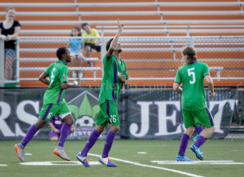 27 June 2015. New Orleans, Louisiana.<br /> National Premier Soccer League. NPSL. <br /> Jesters 1- Georgia Revolution 5.<br /> Jesters score and celebrates their only goal as the New Orleans Jesters lose 1-5 to the Georgia Revolution in a lightning delayed game at home in the Pan American Stadium. <br /> Photo&copy;; Charlie Varley/varleypix.com