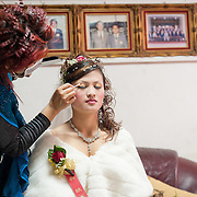 Makeup is applied to brides face on her wedding day. Namasiya Township, Kaoshiung County, Taiwan