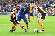 Chelsea midfielder Victor Moses (15) under attack from Hull City defender Andrew Robertson (3) and Hull City midfielder Sam Clucas (11) during the Premier League match between Hull City and Chelsea at the KCOM Stadium, Kingston upon Hull, England on 1 October 2016. Photo by Ian Lyall.