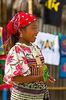 Kuna Indian girl in native costume holding parakeet, Wichub Wala Island, San Blas Islands (Kuna Yala), Caribbean Sea, Panama
