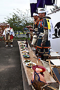 Samurai during a toast at the house of Samurai Fuku Taisho during the Soma Nomaoi festival in Minami Soma.