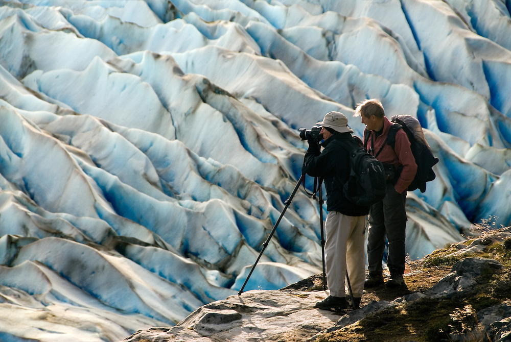 Photographer Sebastiao Salgado, and his assistant Jacques Barthelemy, photographing the Grey Glacier in Torres Del Paine National Park, Patagonia, Chile.