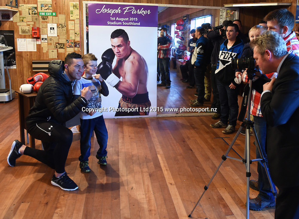 New Zealand Heavyweight boxer Joseph Parker with a young fan during a training session ahead of the Burger King Road to the Title fight in Invercargill, New Zealand. Thursday 30 July 2015. Copyright photo: Andrew Cornaga / www.photosport.nz