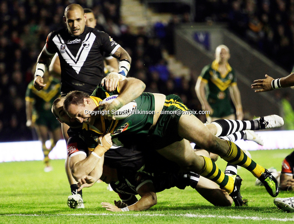 PICTURE BY VAUGHN RIDLEY/SWPIX.COM...Rugby League - Gillette 4 Nations 2011 - Australia v New Zealand - Halliwell Jones Stadium, Warrington, England - 28/10/11…Australia's Matthew Scott scores the first try.