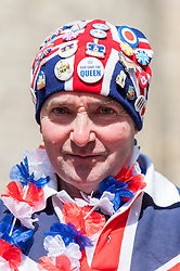 © Licensed to London News Pictures. 20/04/2016. Windsor, UK. John Loughrey, 61, is one of the keen royal fans who will camp out overnight in order to be in prime position in order to see The Queen as she takes part in a walkabout outside Windsor Castle tomorrow her 90th birthday tomorrow.  Photo credit : Stephen Chung/LNP