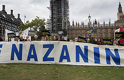 "© Licensed to London News Pictures. 11/10/2017. London, UK. Amnesty International campaign in Parliament Square for the release of British-Iranian Nazanin Zaghari-Ratcliffe who is in custody in Iran. Mrs Zaghari-Ratcliffe is serving a five-year jail term in Iran after being accused of trying to orchestrate a ""soft overthrow"" of Iran. She facing a further 16 years in custody after fresh charges were brought. Photo credit: Peter Macdiarmid/LNP"