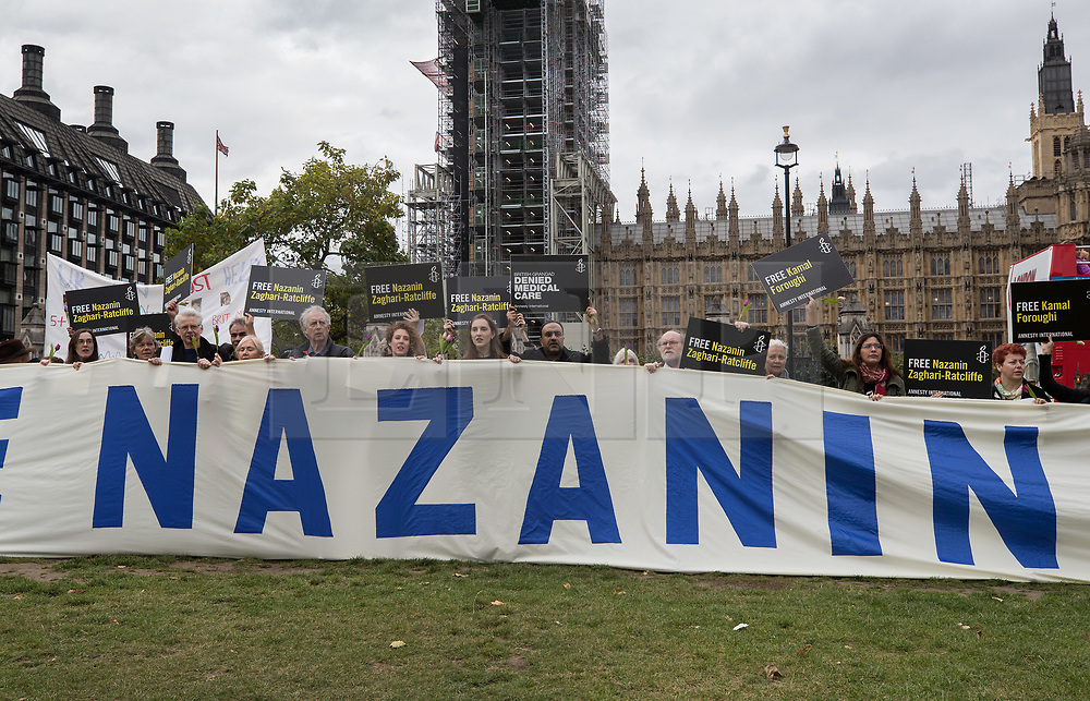 """© Licensed to London News Pictures. 11/10/2017. London, UK. Amnesty International campaign in Parliament Square for the release of British-Iranian Nazanin Zaghari-Ratcliffe who is in custody in Iran. Mrs Zaghari-Ratcliffe is serving a five-year jail term in Iran after being accused of trying to orchestrate a """"soft overthrow"""" of Iran. She facing a further 16 years in custody after fresh charges were brought. Photo credit: Peter Macdiarmid/LNP"""