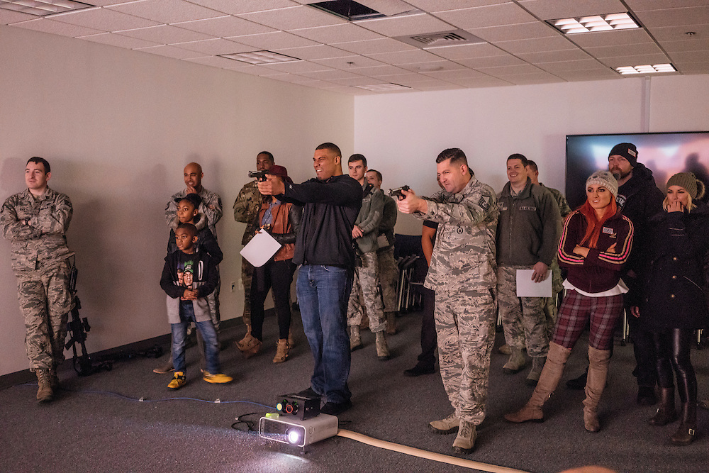 Prince George's County, MD - December  13, 2016:  WWE Superstar Jason Jordan, center, competes against MSgt. Eric Smith, right, using weapons fitted with lasers in a hostage simulation video during Tribute to the Troops Day at the Joint Base Andrews in Prince George's County, Maryland.  WWE Superstars will spend time with members of all five branches of the military.  WWE began Tribute to the Troops in 2003 as a way to honor our servicemen and women and their families.   (Greg Kahn for ESPN)