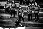 Soccer hooligan with Polish riot police at Legia Warsaw v TS Wisla Krakow Poland, March 1990.
