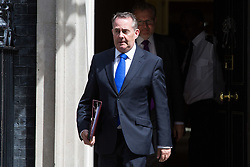 London, July 18th 2017. In a clear demonstration of unity with a cabinet that has seemed to be split over Brexit and other issues,  Government ministers, L-R International Trade Secretary Liam Fox and Scotland Secretary David Mundell leave the last cabinet meeting together before the Parliamentary summer recess at Downing Street in London.