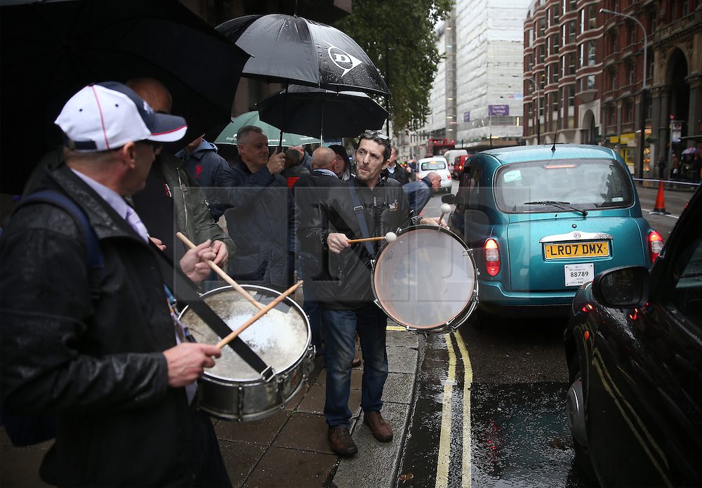 © Licensed to London News Pictures. 05/10/2015. London, UK.  Cab drivers demonstrate outside Transport for London's headquarters in an ongoing protest. Photo credit: Peter Macdiarmid/LNP
