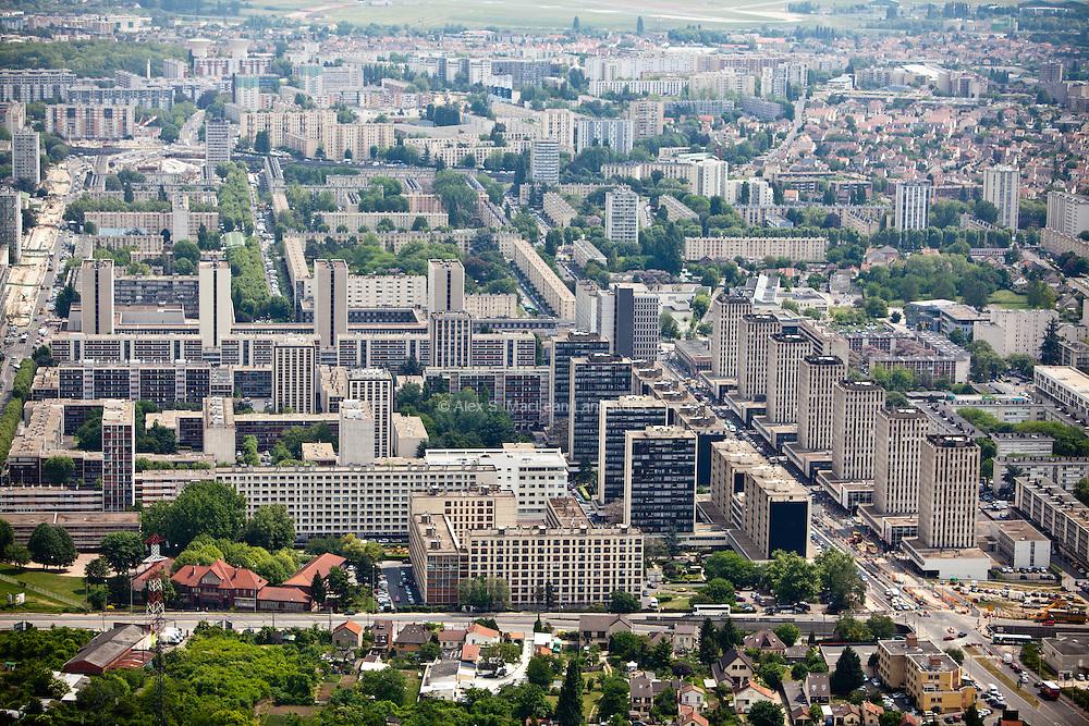 Sarcelles, département du Val-d'Oise (95), le grand stade+Sarcelles Lochères, identical mid rise towers and similar buildings give sense of monotony.