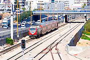 Israel, Tel Aviv, Railway and train near the Ayalon Highway pasing through Tel Aviv from north to south