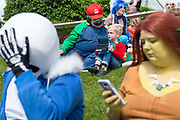 UNITED KINGDOM, London: 27-28 May 2017 Cosplay fans sit and relax at the MCM London Comic Con. <br /> The comic convention, which will be visited by tens of thousands of comic book and cosplay fans, is being held at London's ExCel this weekend. Rick Findler / Story Picture Agency
