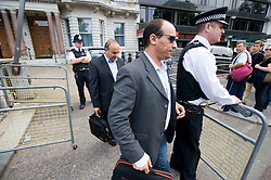 © licensed to London News Pictures.  29/07/2011. London, UK. Staff leaving the Libyan Embassy today (29/07/2011). Today is the deadline for the charges d'affaires, the most senior Libyan representative in the UK, to leave the country. Britain has granted political recognition to the Libyan opposition the deadline for the Charges. Photo credit: Ben Cawthra/LNP
