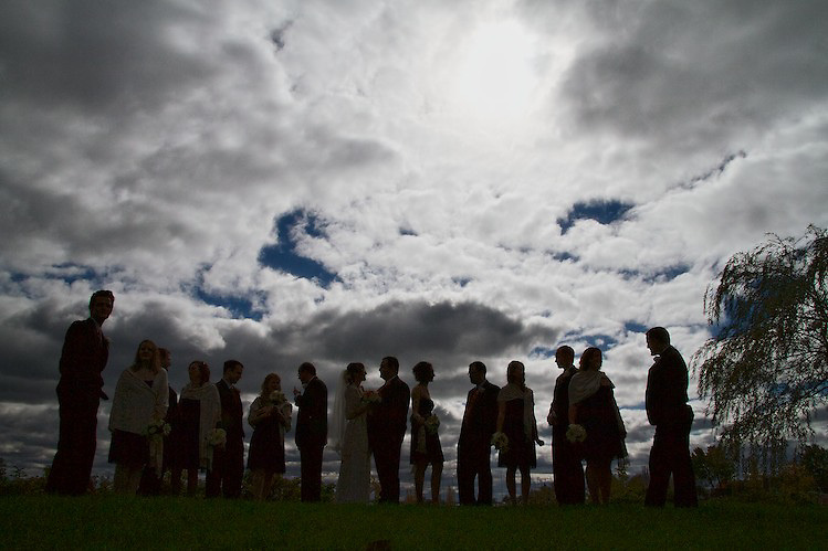 The bridal party in silhouette. To view the newlywed's complete Wedding Gallery Collection, please visit the Client Area and log-in. You'll be able to view these and other images as a slideshow, order prints and more.