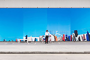 DUBAI, UAE - APRIL 30, 2016: A security guard is standing in front of a temporary installation by artist Mohammed Kazem, which welcomes visitors at Alserkal Avenue in Dubai' Al Quoz Industrial Area.