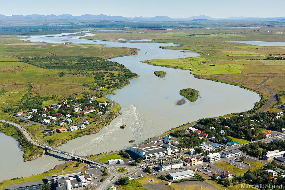 Selfoss - Ölfusá séð til norðurs, Sveitarfélagið Árborg, á/við efri hólmanum í bakgrunni getur komið stiflugerð og ný brú á hringveginum  /  Selfoss and river Olfusa. Viewing north. In the background is a possible site for a new bridge on mainroad nr 1 - as well as a dam for a hydroelectric power plant, Sveitarfelagid Arborg.