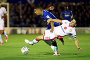 AFC Wimbledon striker Kweshi Appiah (9) battles for possession with Milton Keynes Dons defender George Williams (2) during the EFL Sky Bet League 1 match between AFC Wimbledon and Milton Keynes Dons at the Cherry Red Records Stadium, Kingston, England on 22 September 2017. Photo by Matthew Redman.