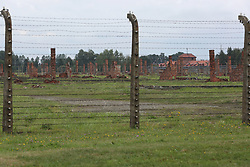 Stoves and chimneys are all that remain of many of the buildings, at the Auschwitz-Birkenau Nazi concentration camps in Auschwitz, Poland on September 3, 2017. Auschwitz concentration camp was a network of German Nazi concentration camps and extermination camps built and operated by the Third Reich in Polish areas annexed by Nazi Germany during WWII. It consisted of Auschwitz I (the original camp), Auschwitz II–Birkenau (a combination concentration/extermination camp), Auschwitz II–Monowitz (a labor camp to staff an IG Farben factory), and 45 satellite camps. In September 1941, Auschwitz II–Birkenau went on to become a major site of the Nazi Final Solution to the Jewish Question. From early 1942 until late 1944, transport trains delivered Jews to the camp's gas chambers from all over German-occupied Europe, where they were killed en masse with the pesticide Zyklon B. An estimated 1.3 million people were sent to the camp, of whom at least 1.1 million died. Around 90 percent of those killed were Jewish; approximately 1 in 6 Jews killed in the Holocaust died at the camp. Others deported to Auschwitz included 150,000 Poles, 23,000 Romani and Sinti, 15,000 Soviet prisoners of war, 400 Jehovah's Witnesses, and tens of thousands of others of diverse nationalities, including an unknown number of homosexuals. Many of those not killed in the gas chambers died of starvation, forced labor, infectious diseases, individual executions, and medical experiments. In 1947, Poland founded a museum on the site of Auschwitz I and II, and in 1979, it was named a UNESCO World Heritage Site. Photo by Somer/ABACAPRESS.COM