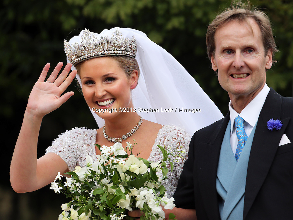 Lady Melissa Percy and her father The Duke of Northumberland   arrive for her wedding to Mr.Thomas van Straubenzee , with bridesmaid Chelsy Davy (left) at St.Michaels Church, Alnwick, Northumberland,  Saturday, 22nd June 2013<br /> Picture by:  Stephen Lock / i-Images