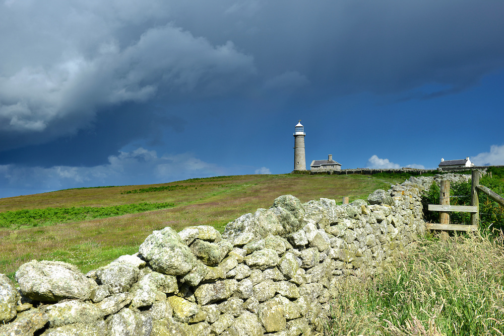 Storm clouds gathering over The Old Light, Lundy Island, Devon