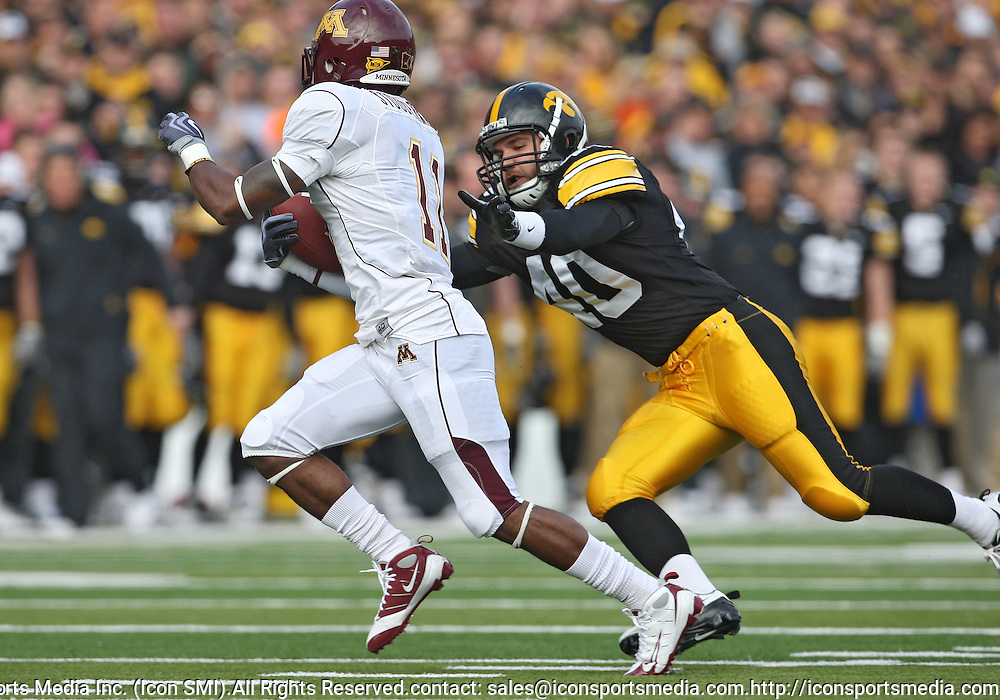 November 21, 2009: Iowa cornerback Jack Swanson (40) tries to tackle Minnesota wide receiver Troy Stoudermire Jr. (11) during the first half of the Iowa Hawkeyes 12-0 win over the Minnesota Golden Gophers at Kinnick Stadium in Iowa City, Iowa on November 21, 2009.